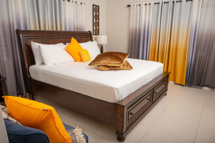 Fully air-conditioned master bedroom with king size bed and TV