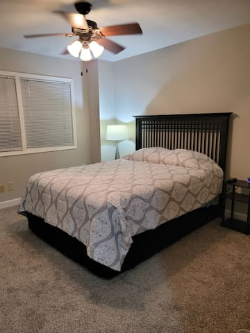 Bedroom 1 is spacious and modern. Enjoy a backyard view through the windows, body mirror on the wall, plenty of outlets on the nightstands including USB ports. The bed is a queen and always has clean, fresh bedding!