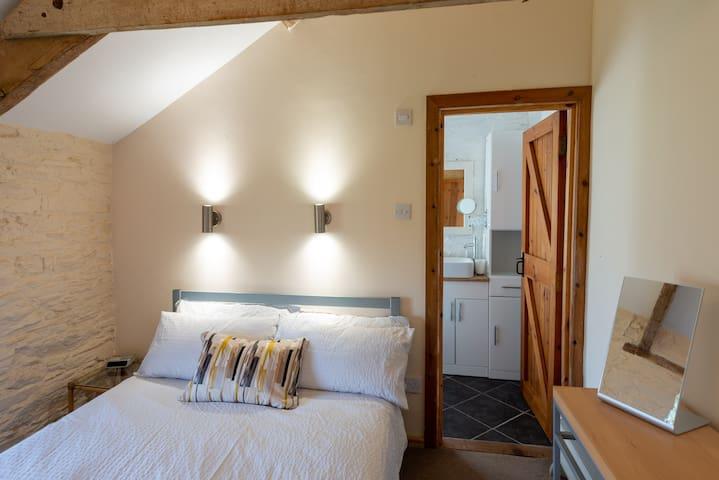 Bedroom 1 with door to en-suite