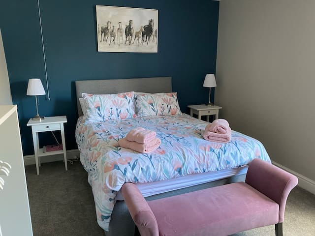 Very large bedroom with King Bed, plenty of hanging space and drawers. Blackout curtains and hairdryer.