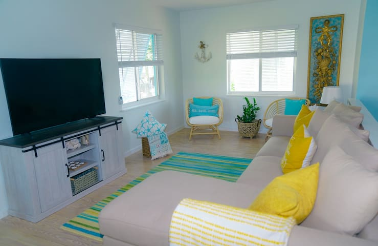 living room with smart tv and sofa queen bed