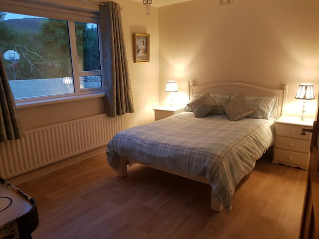 Double bedroom with air hockey table