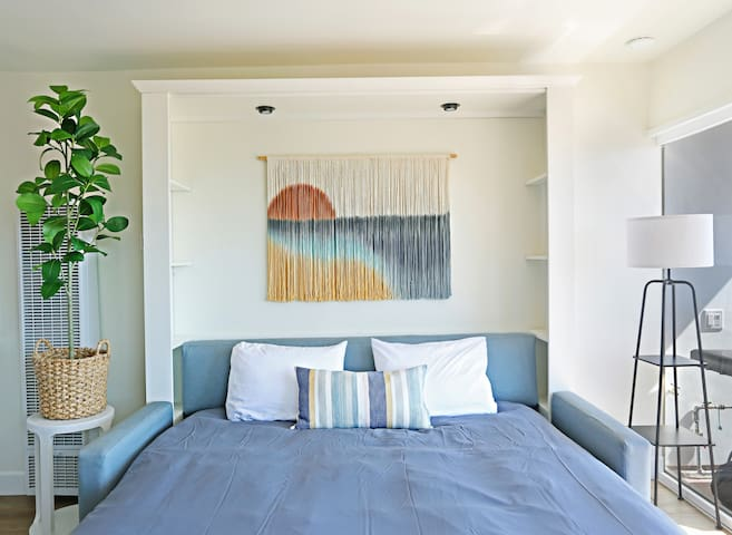 Here is a picture of the king-sized sofa murphy bed expanded. This bed is every bit as comfortable as a traditional bed with a premium mattress. This King murphy bed enables this one-bedroom condo to accommodate up to four people comfortably.