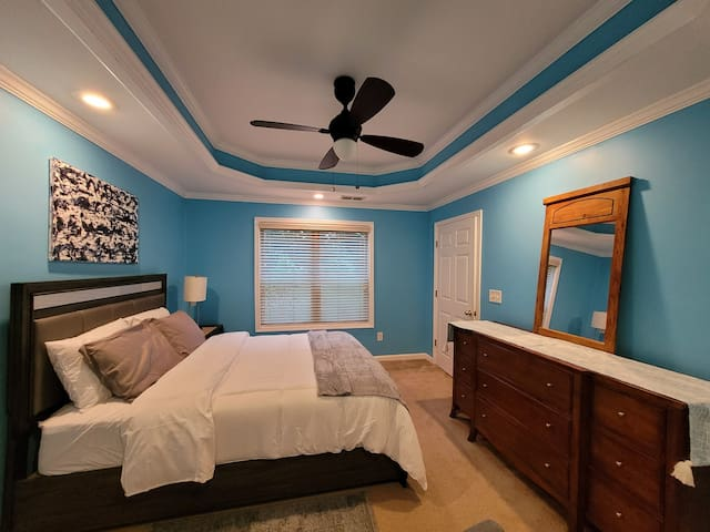 Bedroom #1 with queen size bed and plush mattress, dresser w/ mirror, and night stand