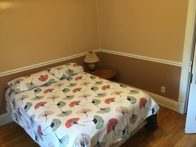 Full bed in back bedroom