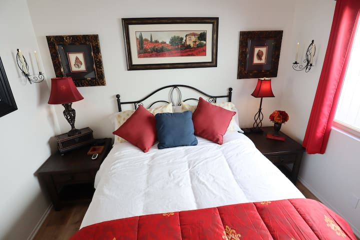 Enjoy our Red Room with queen sized bed, real wax electronic candles , mood lighting for a romantic evening.