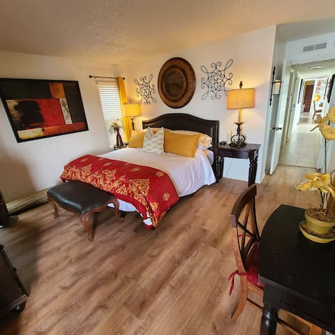 """Wake up refreshed in our Master suite,  luxury King Mattress & pillows, Spanish Style Art, walk out deck, Large Spanish Credenza,  50"""" ROKU TV,  a make-up table or desk for laptop computer, Dimmable Lamps and Electronic Candles for ambiance."""