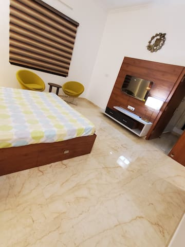Fully furnished bedroom with a double bed and widescreen LED TV as well as seating area....