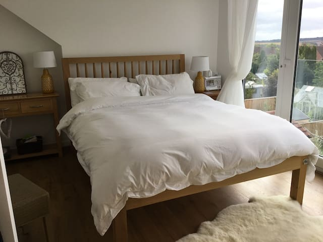 Comfortable king size bed in Bedroom 1