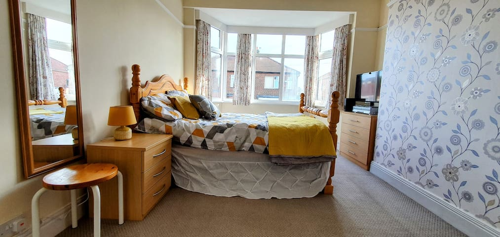 Main bedroom with king size bed and TV.