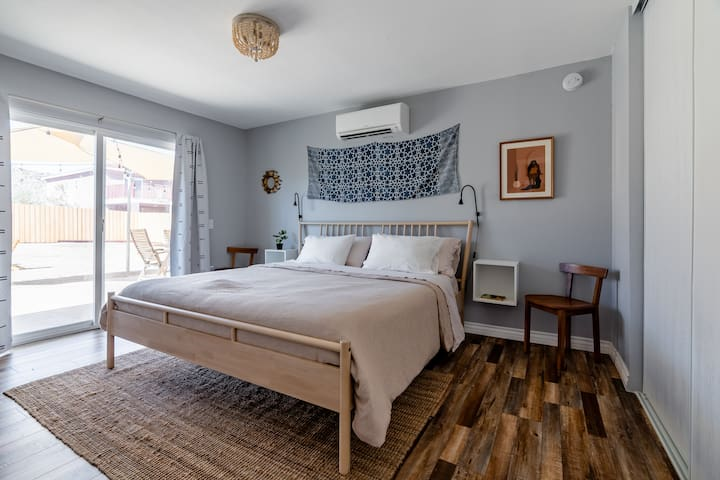 Get a peaceful night's sleep on the king sized Avocado organic mattress and organic bedding in the main bedroom.