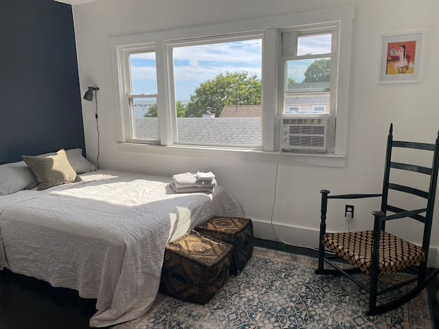 Bedroom 2 (queen size bed), bay windows provide views of the ocean. AC window unit, closet and dresser for your belongings.