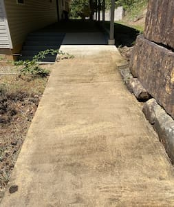 Ramp from driveway to back door.
