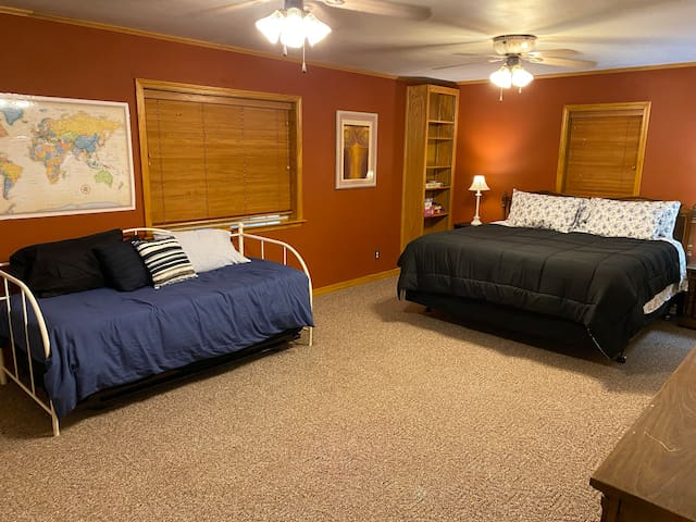 Master bedroom with a king bed, a twin day bed and a twin trundle. (Twins are great for kids).