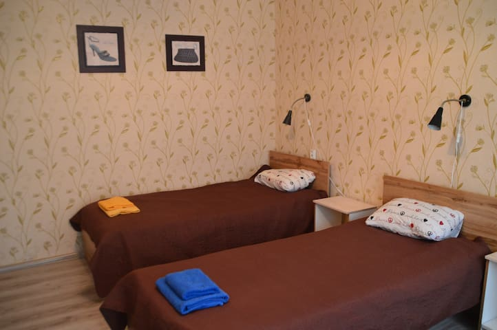 Bedroom 2 - three beds and a balcony