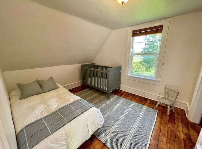 Upstairs kids room features a comfy twin bed (also suitable for an adult), mini chair, walk-in closet, and full-size crib