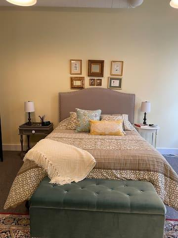 Master bedroom. Has a desk/vanity, dresser, and smart TV.