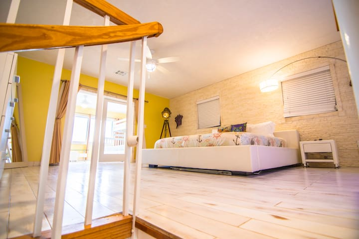 """Third bedroom is elegant master bedroom is furnished with a king-sized bed and a 56"""" curved TV located on the second floor."""