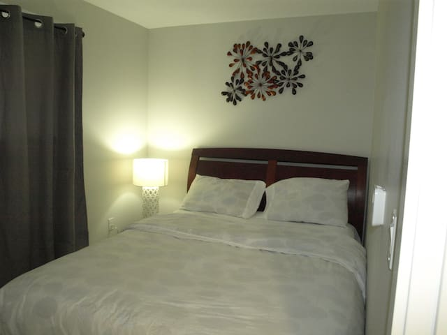 Comfy Queen bed with clean beddings.