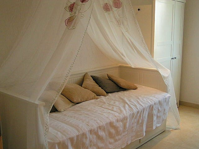 A bedroom with a bed, which can be used as a single bed, and has a draw underneath which can also be used as a single bed or together as a double bed.  The bedroom is on the same level as the living room.