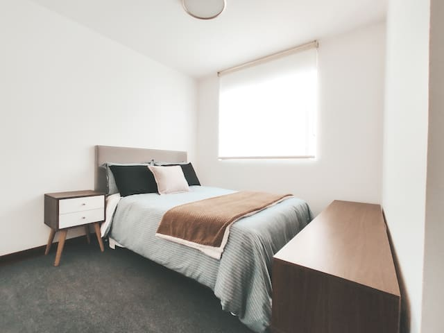 2nd room, with a double bed and spacious closet space!