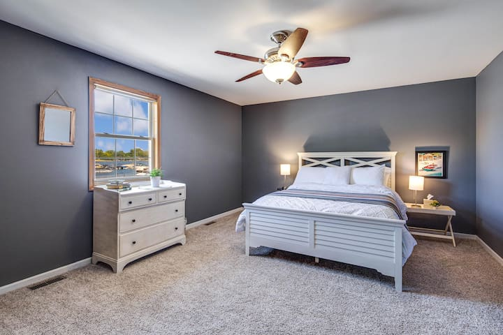 Bedroom #2 with queen sized bed overlooks Bangs Lake and the marina