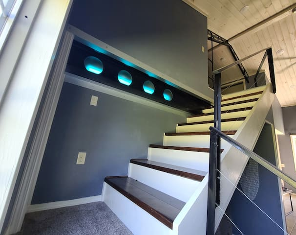The super cool I-beam that defines this apartment has LED lighting w remote that can be color changed and dimmed.
