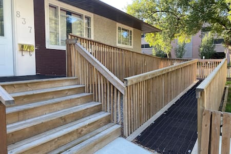 There is a ramp and stairs to access the house.