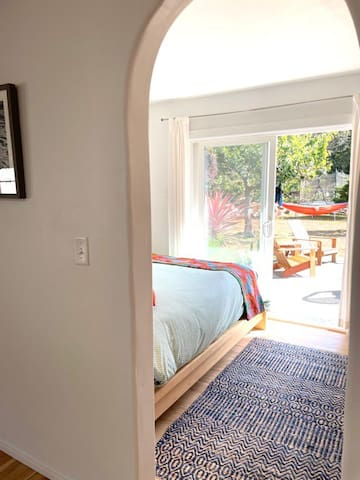 Your private sanctuary. Please note that the bedroom has an archway without a door. The space is an open floor plan.