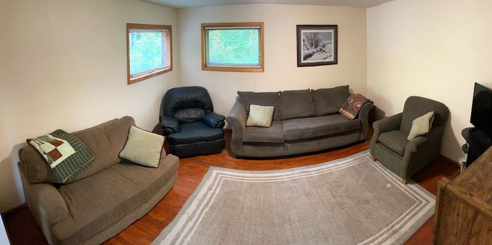 Living Room with pull out sleeper in love seat