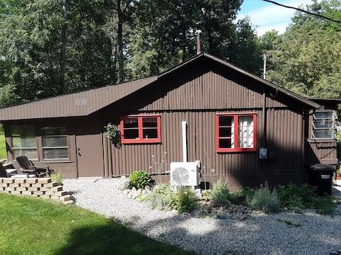 "The ""Little Brown Jug"" lake-side cabin."