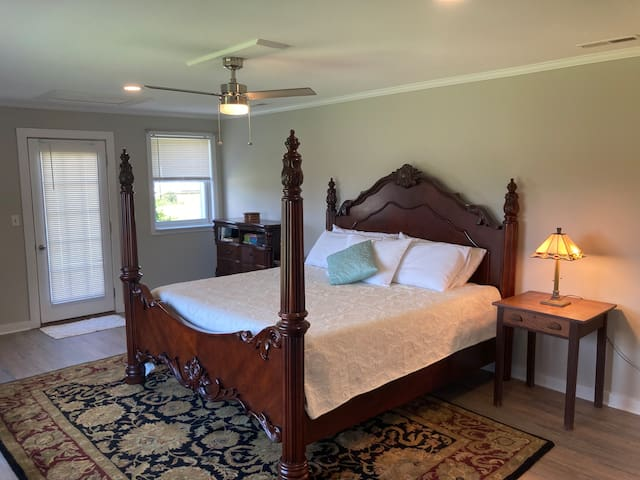 Main bedroom features a king bed with memory foam mattress.