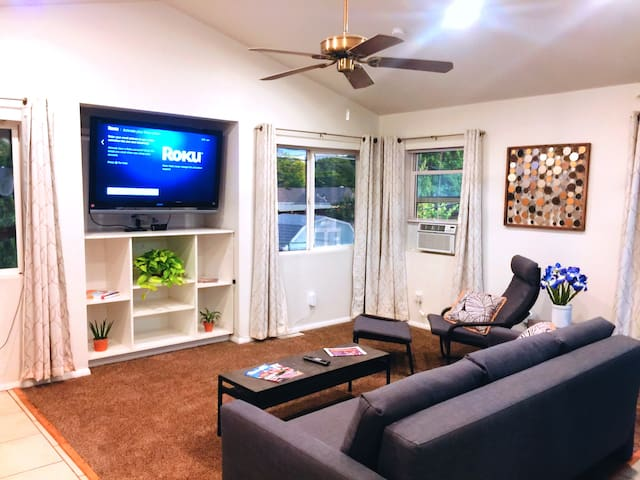 """""""Living Room (1)"""".  Watch a favorite program or sit and chat with your fellow guests. To the left of this picture, there is a door that leads out onto the back deck."""