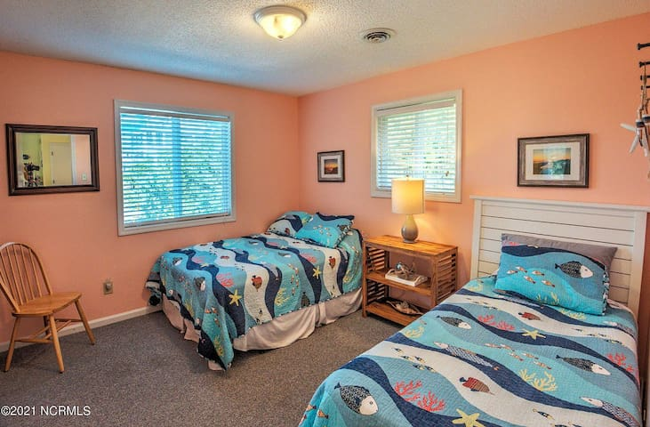 Double bedroom off the kitchen, shares a bathroom with Beach King and features a full size bed and a twin.
