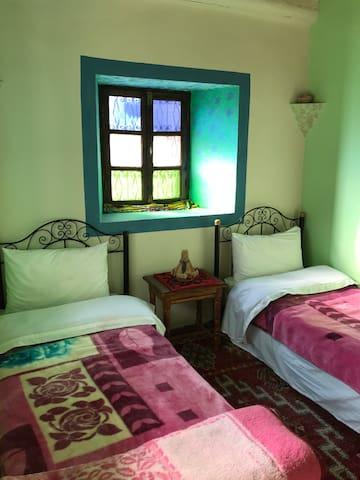 Une des 3 chambres. 3 lits simples
