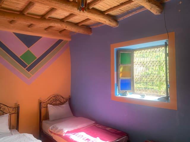 3e chambre avec 3 lits simples.
