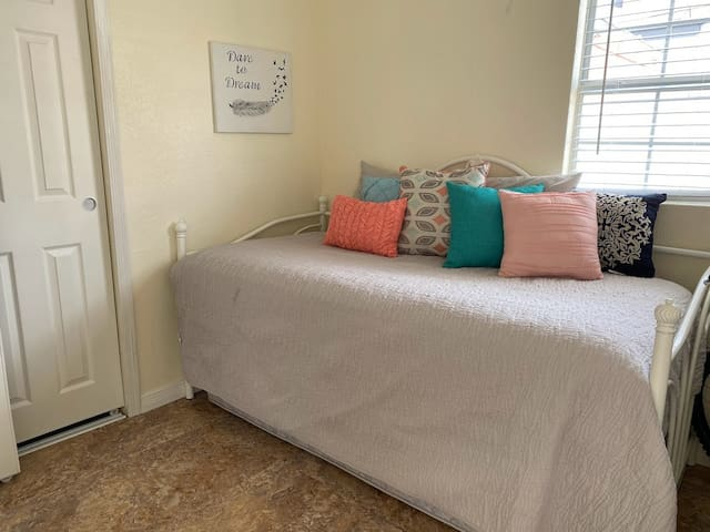 Third bedroom. Two twin beds- One day bed and one pull-out mattress.