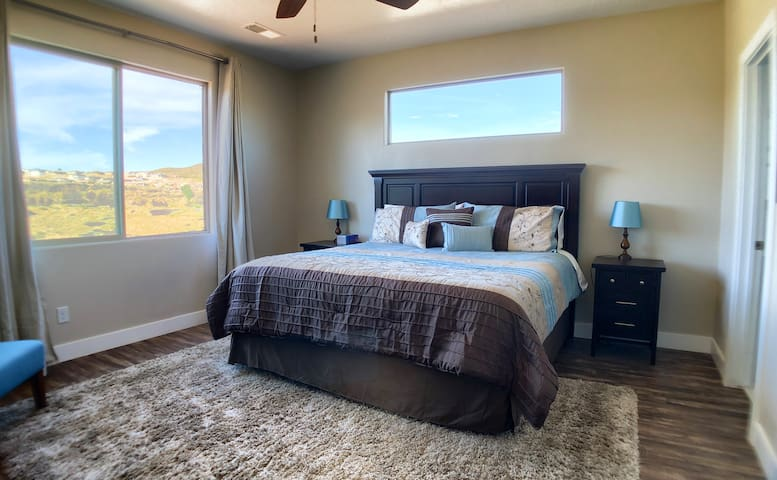 The upstairs master bedroom is spacious with lots of light. It features a private entrance to the balcony and an en suite bathroom.