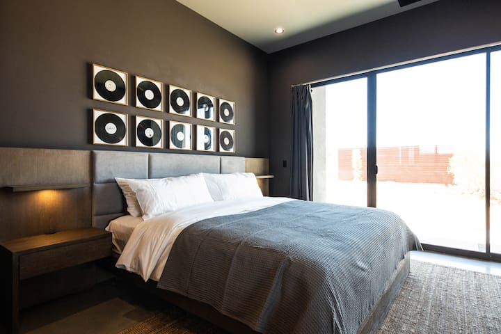 Stylish master bedroom of Black House