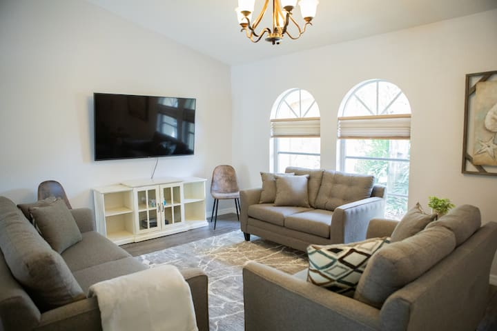 living room with sleeper couch and 65in TV