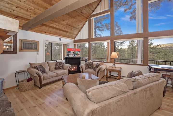 Family room overlooking the beautiful Ponderosa Pines. Smart TV, 2 fireplaces (1 pellet and 1 electric), and swamp cooler to keep the temps cool in the summer when needed.