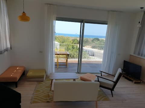 Rooftop studio with sea views