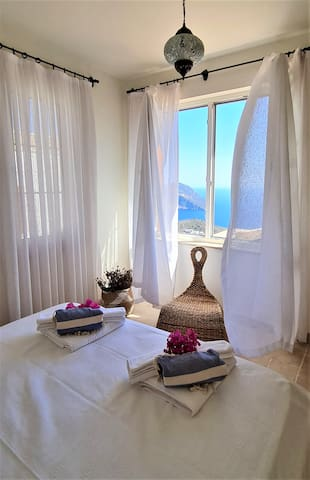 Fully air conditioned, spacious and cozy rooms await to welcome you to relax and enjoy your well deserved holidays. This room has its own en suite bathroom and large closet. All rooms at Villa Pairidaeza have stunning views of the sea.