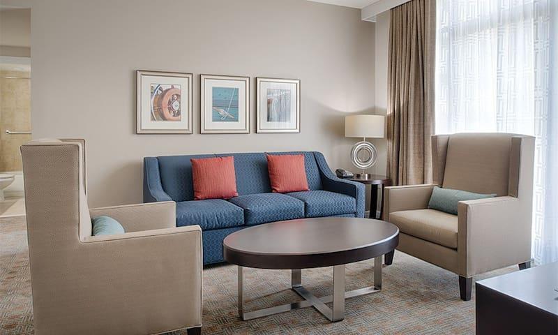 Sample 2 bedroom living room with sleeper sofa.