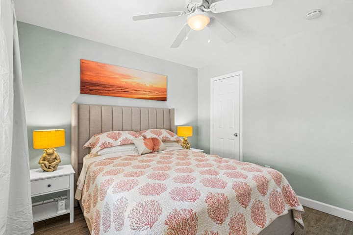 Comfortable Queen size bed with cooling, hybrid mattress and plenty of outlets for charging.