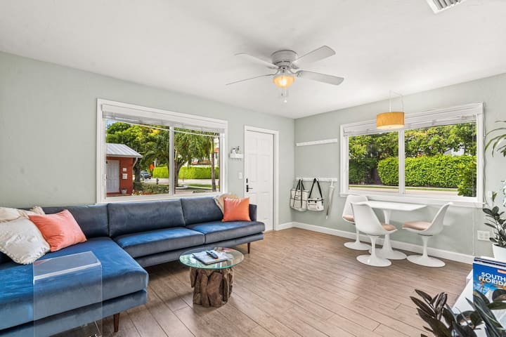 Light, bright living area is waiting for you! Couch comfortably seats 3-4 and is long enough to sleep on.