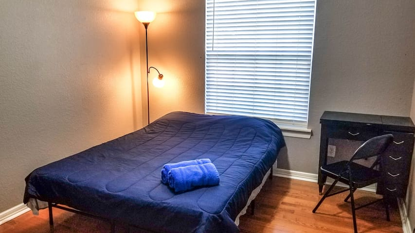 Guest bedroom with queen-size bed and desk