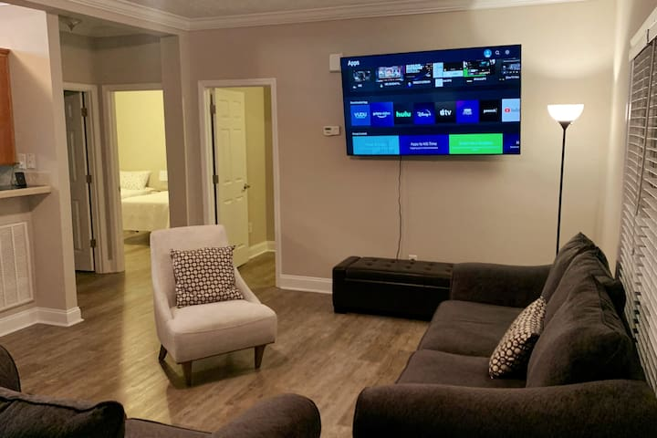 """Living room with fantastic 70"""" QLED Samsung Smart TV. Samsung Streaming Service is included or you can log in to practically any streaming service or use Airplay from your phone or tablet."""