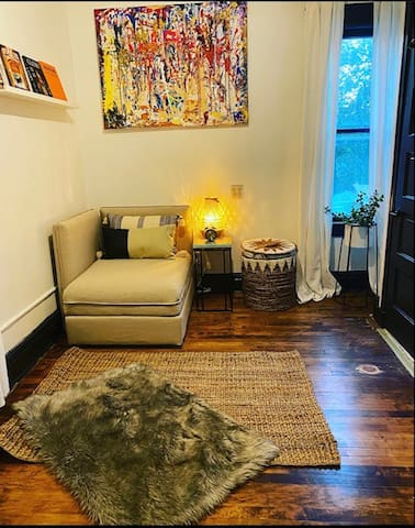 This is our beautiful bonus bedroom/ lounge area. The pictured oversized chair turns into a twin size bed, which we have a cozy full size comforter, 500 thread count breathable sheets, & pillow.