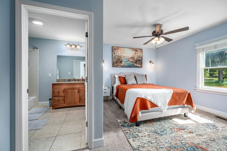 Master bedroom with attached bathroom. Queen bed and Smart TV